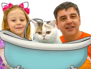 Stacy and dad bathe and dress up her kitty