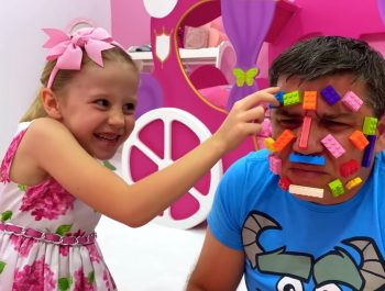 Nastya and dad play with lego toys